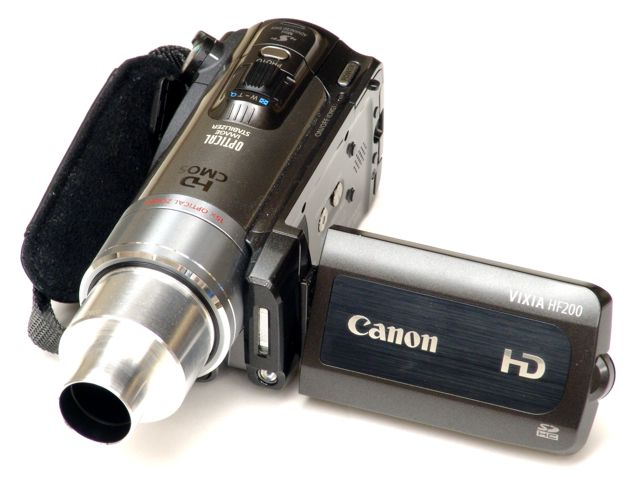 Canon HF200 video camera with 23mm eyetube adapter attached