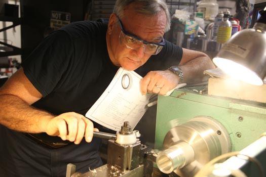 Richard Kinch cutting a microscope adapter on a metalworking lathe